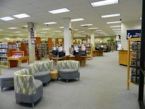 A view of the Pearsall Public Library, including shelves and seating.